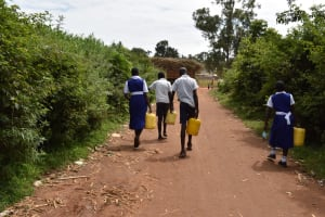 The Water Project: Shamberere Primary School -  Carrying Water