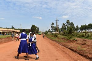 The Water Project: Shamberere Primary School -  Crossing Busy Road For Water