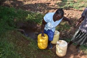 The Water Project: Iyala Community, Iyala Spring -  Carrying Water