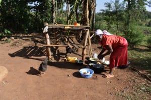 The Water Project: Iyala Community, Iyala Spring -  Washing Dishes