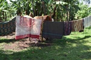 The Water Project: Iyala Community, Iyala Spring -  Bedding On Clothesline