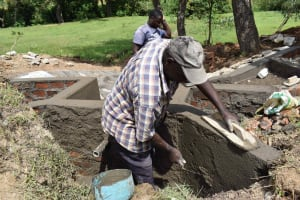 The Water Project: Luyeshe North Community, Reuben Endeche Spring -  Plastering Works