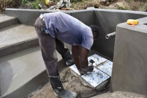 The Water Project: Luyeshe North Community, Reuben Endeche Spring -  Tiles Setting