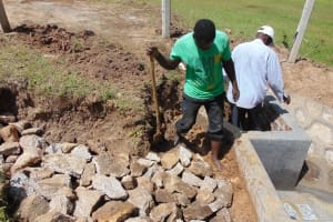 The Water Project: Luyeshe North Community, Reuben Endeche Spring -  Backfilling With Clay