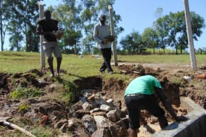 The Water Project: Luyeshe North Community, Reuben Endeche Spring -  Backfilling With Stone