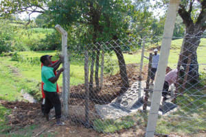 The Water Project: Luyeshe North Community, Reuben Endeche Spring -  Fencing Process