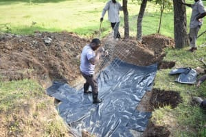 The Water Project: Luyeshe North Community, Reuben Endeche Spring -  Slab Setting