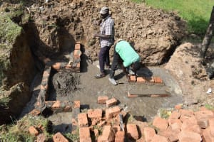 The Water Project: Luyeshe North Community, Reuben Endeche Spring -  Brick Setting