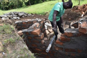 The Water Project: Luyeshe North Community, Reuben Endeche Spring -  Pipe Setting