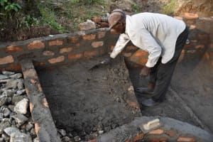 The Water Project: Luyeshe North Community, Reuben Endeche Spring -  Stairs Floor Setting