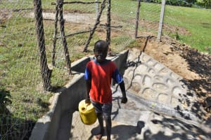 The Water Project: Luyeshe North Community, Reuben Endeche Spring -  Enock Carrying Water