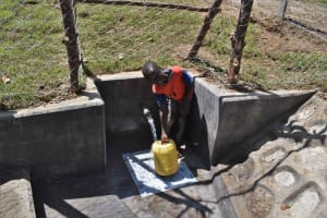 The Water Project: Luyeshe North Community, Reuben Endeche Spring -  Enock Fetching Water