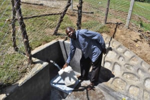The Water Project: Luyeshe North Community, Reuben Endeche Spring -  Fetching Water