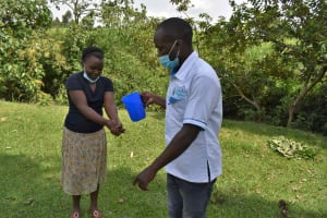 The Water Project: Luyeshe North Community, Reuben Endeche Spring -  Hand Washing Demonstration