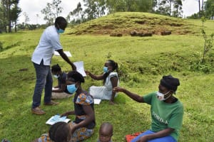 The Water Project: Luyeshe North Community, Reuben Endeche Spring -  Issuing Out The Leaflets