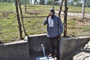 The Water Project: Luyeshe North Community, Reuben Endeche Spring -  John Drinking Clean Water