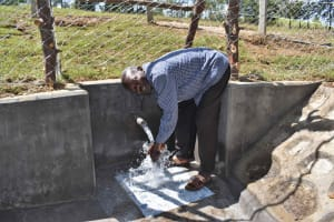 The Water Project: Luyeshe North Community, Reuben Endeche Spring -  John Washing Hands