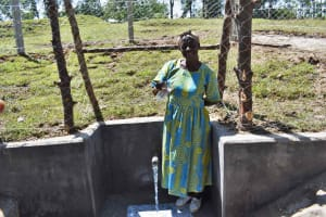 The Water Project: Luyeshe North Community, Reuben Endeche Spring -  Miriam Drinking Water