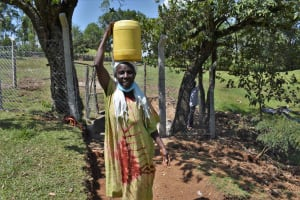 The Water Project: Luyeshe North Community, Reuben Endeche Spring -  Rose Carrying Clean Water