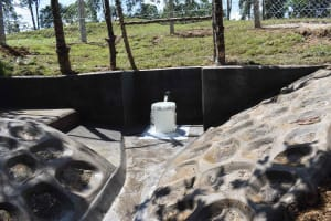 The Water Project: Luyeshe North Community, Reuben Endeche Spring -  Water Flowing