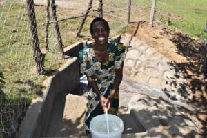 The Water Project: Luyeshe North Community, Reuben Endeche Spring -  Carrying Clean Water