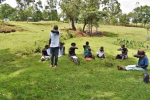 The Water Project: Luyeshe North Community, Reuben Endeche Spring -  Demonstration On Coughing Safely