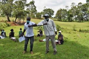 The Water Project: Luyeshe North Community, Reuben Endeche Spring -  Demonstration On Safe Greeting