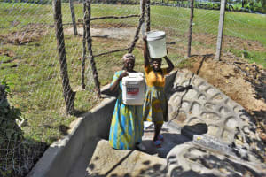 The Water Project: Luyeshe North Community, Reuben Endeche Spring -  Women Carrying Clean Water