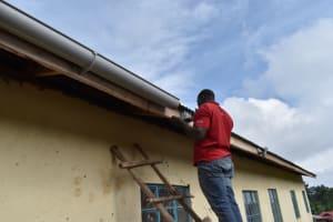 The Water Project: Kabinjari Primary School -  Fixing Gutters