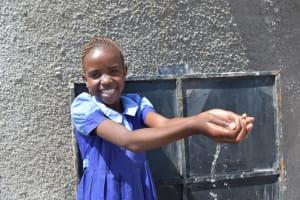 The Water Project: Kabinjari Primary School -  Student Celebrates Water
