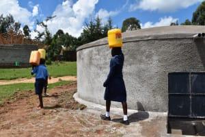 The Water Project: Kabinjari Primary School -  Students Carrying Water