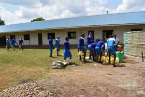 The Water Project: Friends Mudindi Village Primary School -  Students Getting Water