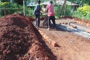 The Water Project: Friends Mudindi Village Primary School -  Latrine Concrete Placement