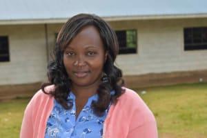 The Water Project: Friends Mudindi Village Primary School -  Madam Peninah Nyamao