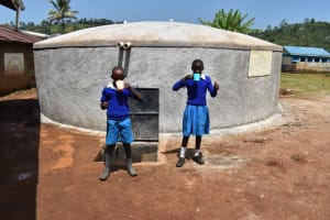 The Water Project: Friends Mudindi Village Primary School -  Students Having Water