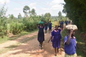The Water Project: Petros Primary School -  Pupils Bring Sand