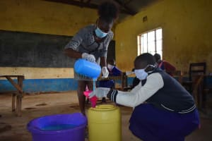The Water Project: Petros Primary School -  Student Assisting