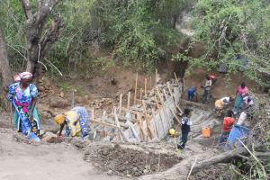 The Water Project: Kathamba ngii Community B -  Building Up Dam Wall