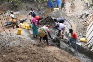 The Water Project: Kathamba ngii Community C -  Laying Cement