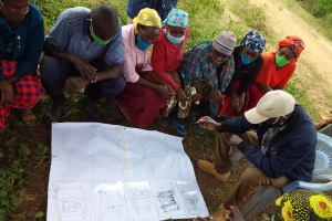 The Water Project: Kitile B Village Well -  Collaborating