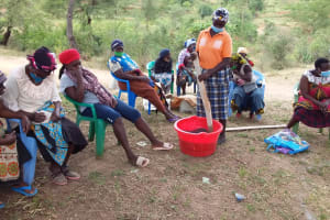 The Water Project: Kitile B Village Well -  Mixing Soap