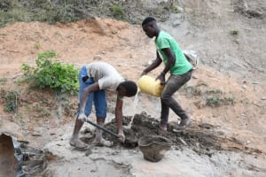 The Water Project: Kitile B Village Sand Dam -  Mixing