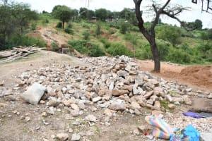 The Water Project: Kitile B Village Sand Dam -  Rocks