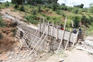 The Water Project: Kitile B Village Sand Dam -  Working Hard