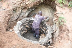 The Water Project: Kitile B Village Well -  Building Walls