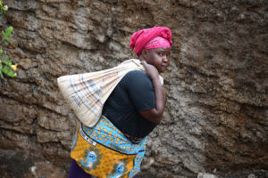The Water Project: Kitile B Village Well -  Lugging Supplies