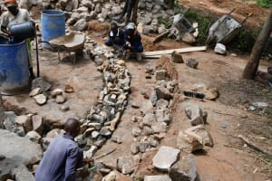 The Water Project: Mbiuni Primary School -  Many Hands