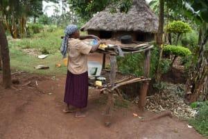 The Water Project: Mungakha Community, Mwilima Spring -  Elina Drying Dishes