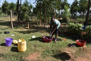 The Water Project: Muhoni Community, Kekongo Forest Spring -  Doricas Doing Laundry