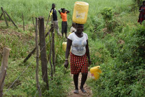 The Water Project: Chombeli Community, Ernest Kuta Spring -  Carrying Water